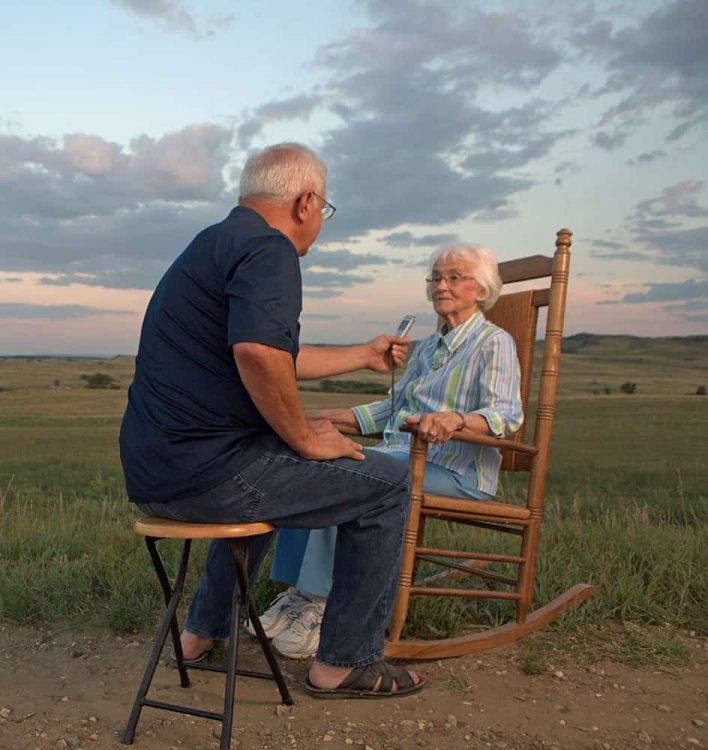 Jim Puppe interviews Pauline (Koch) Roll outside her home in Heil, ND, Grant County.